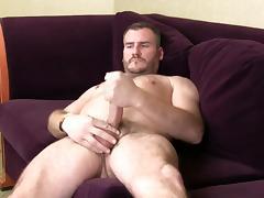 Horny gay hunk masturbates on an interview