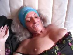 German granny gets some love from a younger man on the couch