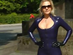 Sexy blonde lady blue latex skirt outdoor