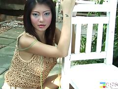 Asian slut sucks on her toy and sits her pussy on it