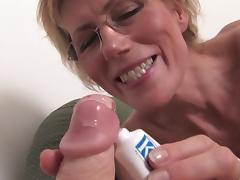 Granny pussy stretches around a dildo as she fucks it