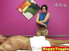 Asian masseuse tugging client on hiddencam