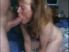Mature wife sucks big dick on the camera.