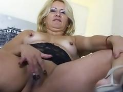 Horny blonde old lady playing about herself