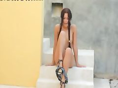 Brunette glamour in heels rubbing a clit
