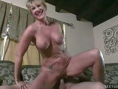 Mature honey's fake tits jizzed