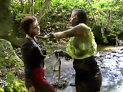 Girls fight in the mud riverside