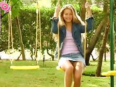 Blonde Girl Peeing While She's On The Swings