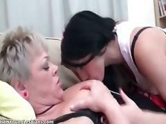 Sweet brunette lesbian is kissing