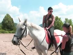 Brunette hottie Aletta Ocean rides a horse on a race course