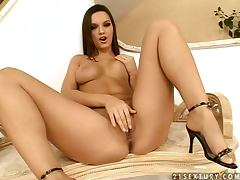 Eve Angel the luxury babe masturbates on a couch