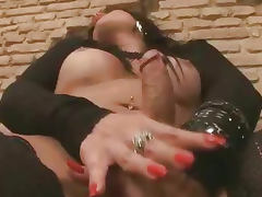 Foxy brunette shemale hottie tugging on her cock