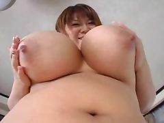 Chubby Asian bitch Hana lets some guy play with her enormous boobs