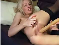 Aged golden haired plays with large toy