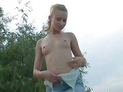 Jena the skinny blonde poses naked by the lake
