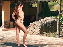 Horny model is doing fitness naked outdoors