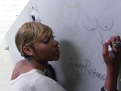 Two naughty girls write and draw something in a gloryhole room