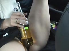 Pretty nice-looking brunette and her bottle
