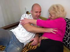 A Horny Granny Gets Bent Over and Fucked by a Younger Guy