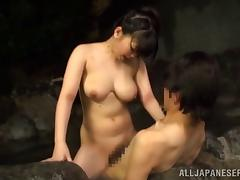 Naughty Asian couple fucking outdoors in a hot tub